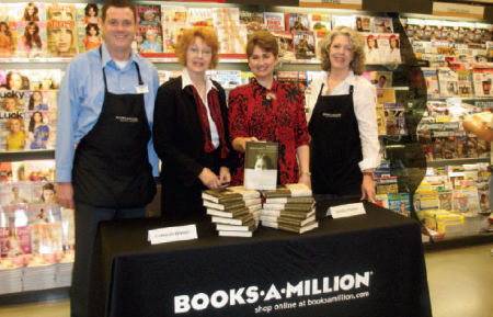 "Carolyn Tomlin, second from left, and Denis George, second from right, promoting 'The Secret Holocaust Diaries"" at a Books-A-Million near Trussville, Ala. (FILE)"